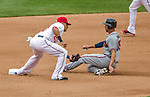 4 April 2014: Washington Nationals shortstop Ian Desmond gets a sliding Andrelton Simmons out stealing in the 5th inning against the Atlanta Braves during the Nationals Home Opening Game at Nationals Park in Washington, DC. The Braves edged out the Nationals 2-1 in their first meeting of the 2014 MLB season. Mandatory Credit: Ed Wolfstein Photo *** RAW (NEF) Image File Available ***
