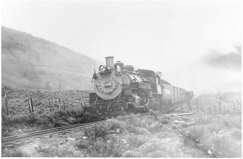 3/4 shot D&amp;RGW #498 pulling southbound freight train just below Crested Butte.<br /> D&amp;RGW  Crested Butte Branch, CO  Taken by Treptow, Russell F. - 1942