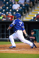 Oklahoma City Dodgers third baseman Brian Burgamy (7) at bat during a game against the Fresno Grizzles on June 1, 2015 at Chickasaw Bricktown Ballpark in Oklahoma City, Oklahoma.  Fresno defeated Oklahoma City 14-1.  (Mike Janes/Four Seam Images)