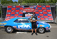 Jun 11, 2017; Englishtown , NJ, USA; Super Stock winner Timothy Fletcher celebrates in the winners circle after winning the Summer Nationals at Old Bridge Township Raceway Park. Mandatory Credit: Mark J. Rebilas-USA TODAY Sports