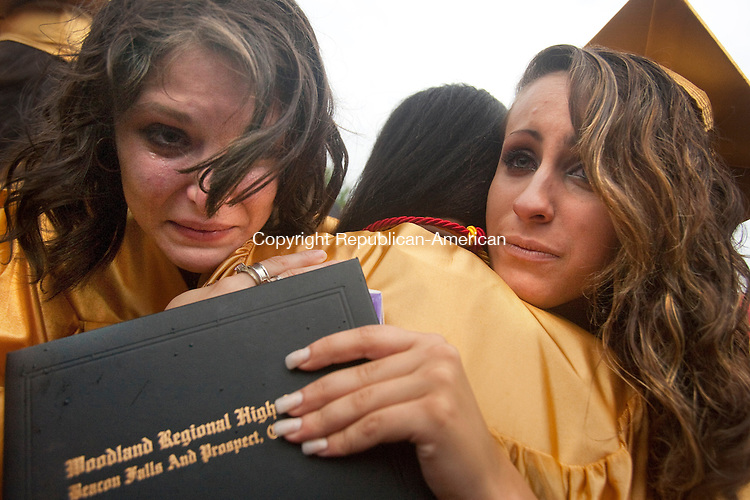 BEACON FALLS, CT 22 JUNE, 2010-062210JS08-Woodland Regional High School graduates Raechel (CQ) Sciortino, left, and Kristine Chicoine, right, give a farewell hug and say goodbye to fellow graduate Kelsey Abney, center, following commencement Tuesday at Woodland Regional High School in Beacon Falls. Abney will leave soon to attend the University of Maryland.<br /> Jim Shannon Republican-American