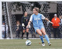 University of North Carolina forward Kealia Ohai (7) looks to pass.  University of North Carolina (blue) defeated Boston College (white), 1-0, at Newton Campus Field, on October 13, 2013.