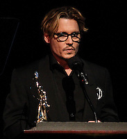 LOS ANGELES, CA - FEBRUARY 15: Actor Johnny Depp receives the Distinguished Artisan Award at the Annual Make-Up Artists And Hair Stylists Guild Awards held at the Paramount Theatre on February 15, 2014 in Los Angeles, California. (Photo by Xavier Collin/Celebrity Monitor)