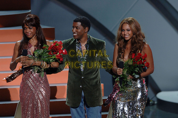 MICHELLE WILLIAMS, BABYFACE & BEYONCE KNOWLES (DESTINY'S CHILD).Perform at The World Music Awards-Show held at the Kodak Theatre,.Hollywood, 31st  August 2005.half length stage gig concert pink shirt velvet suit silver sequin sparkly dress pink roses flowers.www.capitalpictures.com.sales@capitalpictures.com.© Capital Pictures.