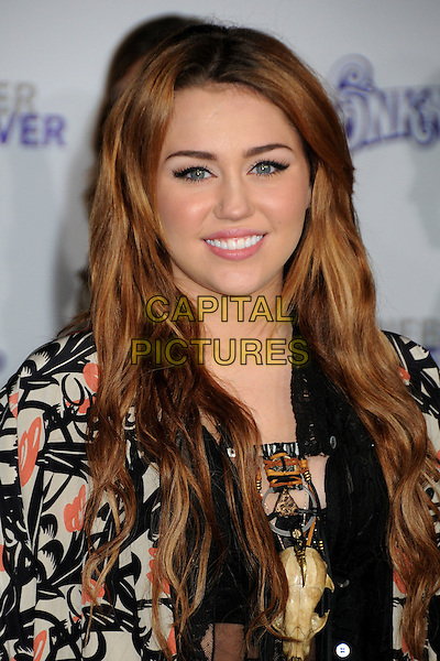 "MILEY CYRUS .""Justin Bieber: Never Say Never"" Los Angeles Premiere held at Nokia Theater L.A. Live, Los Angeles, California, USA, .8th February 2011..portrait headshot smiling black jacket print orange beige make-up beauty .CAP/ADM/BP.©Byron Purvis/AdMedia/Capital Pictures."