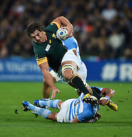 Eben Etzebeth of South Africa is tackled by Ramiro Herrera of Argentina. Rugby World Cup Bronze Final between South Africa and Argentina on October 30, 2015 at The Stadium, Queen Elizabeth Olympic Park in London, England. Photo by: Patrick Khachfe / Onside Images
