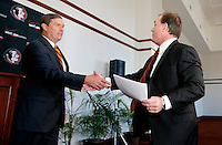TALLAHASSEE, FLA. 1/6/10-FISHER 010610 CH02-Florida State University Athletic Director Randy Spetman, left, congratulates Jimbo Fisher on becoming the new head coach of the football team, Wednesday during a news conference in Tallahassee...COLIN HACKLEY PHOTO