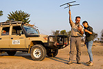African Lion (Panthera leo) biologists, Luke Hunter and Kim Young-Overton, tracking female lion using telemetry, Kafue National Park, Zambia