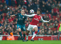 Arsenal's Alex Iwobi and Southampton's Oriol  Romeu during the EPL - Premier League match between Arsenal and Southampton at the Emirates Stadium, London, England on 8 April 2018. Photo by Andrew Aleksiejczuk / PRiME Media Images.