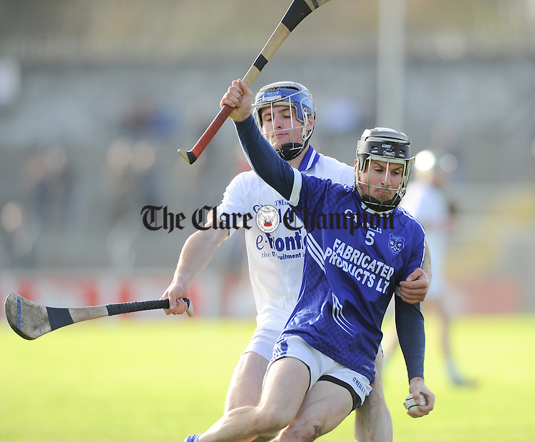 Sean Chaplin of Cratloe in action against Pa Bourke of Thurles Sarsfield's during their Munster Club quarter final in Cusack park. Photograph by John Kelly.