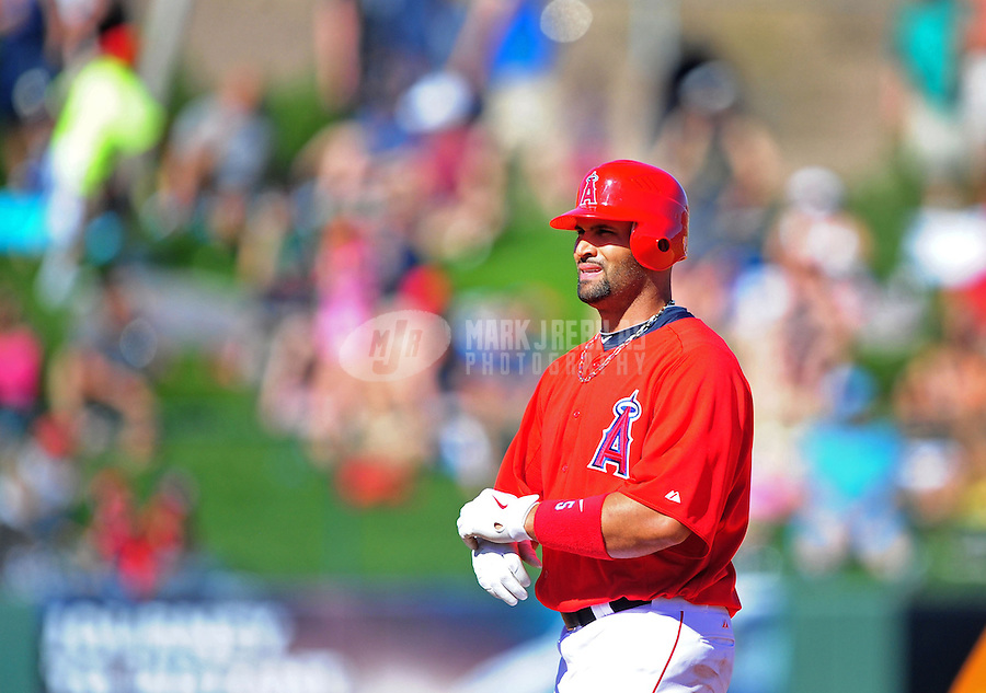 Mar. 6, 2012; Tempe, AZ, USA; Los Angeles Angels designated hitter Albert Pujols on second base after hitting a double in the fourth inning against the Chicago White Sox during a spring training game at Tempe Diablo Stadium.  Mandatory Credit: Mark J. Rebilas-
