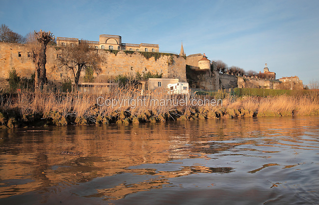 Walls of the ancient village of Bourg, built in Roman times at the confluence of the Dordogne and Garonne rivers, fortified by medieval walls, with the facade of the 18th century Chartreuse, or Castle Citadel above, on the Gironde Estuary, Aquitaine, France. Picture by Manuel Cohen