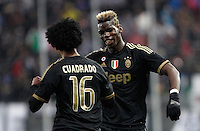 Calcio, Serie A: Frosinone vs Juventus. Frosinone, stadio Comunale, 7 febbraio 2016.<br /> Juventus&rsquo; Juan Cuadrado celebrates with teammate Paul Pogba, right, after scoring during the Italian Serie A football match between Frosinone and Juventus at Frosinone's Comunale stadium, 7 January 2016.<br /> UPDATE IMAGES PRESS/Isabella Bonotto
