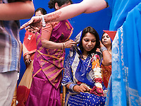 The bride Divya Agarwal prepares to receive gifts during her wedding ceremony with Suketu Soni, Jan. 4, 2008. Agarwal and Soni met on an Indian online dating service in 2001.