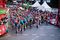 peloton crossing the finish line in the Madrid local laps<br /> <br /> Stage 21: Fuenlabrada to Madrid (107km)<br /> La Vuelta 2019<br /> <br /> ©kramon
