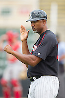 Kannapolis Intimidators hitting coach Robert Sasser (30) coaches third base during the game against the Lakewood BlueClaws at CMC-NorthEast Stadium on July 20, 2014 in Kannapolis, North Carolina.  The Intimidators defeated the BlueClaws 7-6. (Brian Westerholt/Four Seam Images)