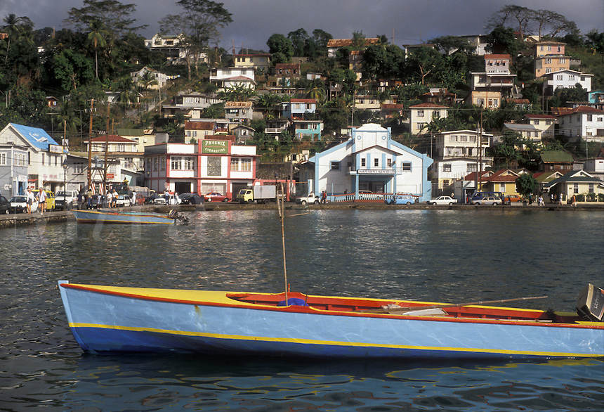 "AJ2523, Grenada, Caribbean, St. George's, Caribbean Islands, Fishing boat anchored on the Carenage Harbor with a view of St. George's the capital of the island of Grenada """"the spice isle"""" (a British Commonwealth member)."
