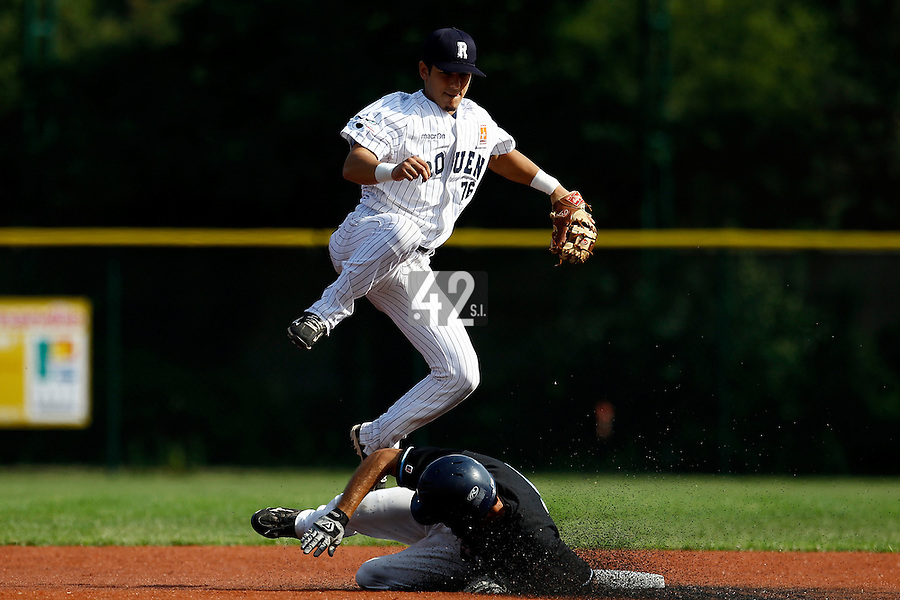 15 July 2011: Maxime Lefevre of the Rouen Huskies jumps over Julien Brelle Andrade during the 2011 Challenge de France match won 6-5 by the Rouen Huskies over the Senart Templiers at Stade Pierre Rolland, in Rouen, France.