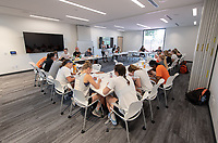 Women's lacrosse team in a team building exercise.<br /> Occidental College's newly remodeled Department of Athletics offices on March 13, 2019.<br /> (Photo by Marc Campos, Occidental College Photographer)
