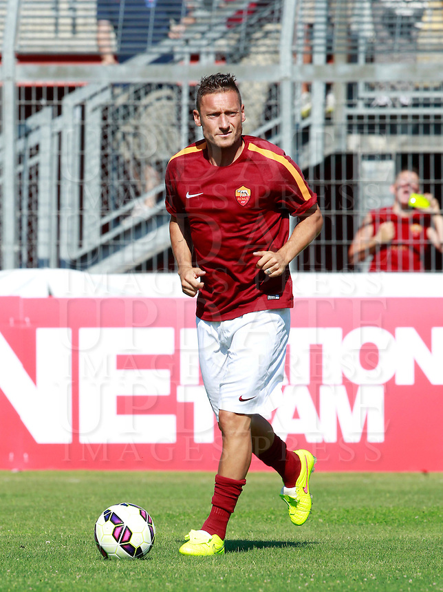 Calcio, amichevole Roma vs Under 23 Indonesia. Rieti, stadio &quot;Manlio Scopigno&quot;, 18 luglio 2014. <br /> AS Roma forward Francesco Totti warms up prior to the start of the friendly football match between AS Roma and Under 23 Indonesia at &quot;Manlio Scopigno&quot; stadium in Rieti, Italy, 18 July 2014.<br /> UPDATE IMAGES PRESS/Isabella Bonotto