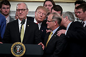 United States President Donald J. Trump listens as US Senator Kevin Cramer (Republican of North Dakota) left, speaks during a welcome ceremony with the 2018 Division I FCS National Champions: The North Dakota State Bison in the State Dining Room of the White House on March 4, 2019 in Washington, DC.<br /> Credit: Oliver Contreras / Pool via CNP