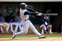 Lastings Milledge #14 of the Charlotte Knights connects for a solo home run in the top of the 2nd inning against the Pawtucket Red Sox at McCoy Stadium on June 12, 2011 in Pawtucket, Rhode Island.  The Red Sox defeated the Knights 2-1.    Photo by Brian Westerholt / Four Seam Images