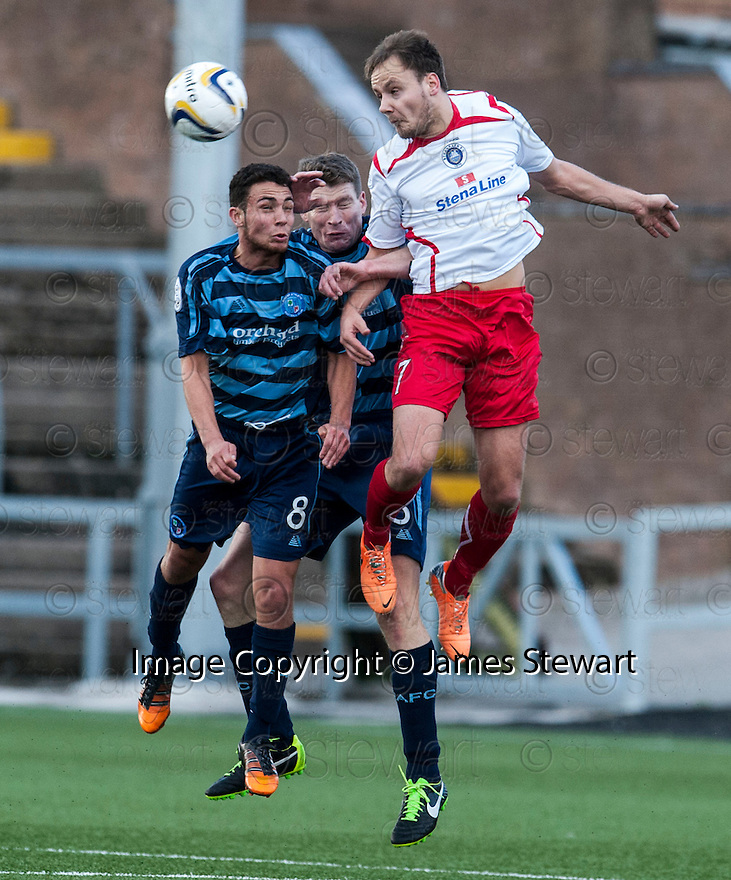 Stranraer's Sean Winter goes for the high ball with Forfar's James Dale and Darren Dods.
