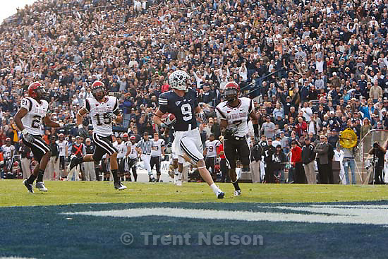 Provo - BYU WR Austin Collie (9) runs for a touchdown, bringing the BYU lead to 34-6. San Diego State defenders (left to right) are Aaron Moore, Jose Perez, and Vonnie Holmes. BYU vs. San Diego State University college football, Saturday, November 8, 2008 at LaVell Edwards Stadium. BYU wins 41-12.