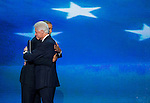 President Barack Obama embraces former President Bill Clinton following Clinton's speech nominating Obama to be the Democratic candidate for President at the Democratic National Convention at Time Warner Cable Arena in Charlotte, N.C., on Wednesday, Sept. 5, 2012.