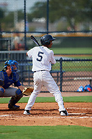 GCL Yankees East shortstop Jose Devers (5) at bat in front of catcher Hagen Danner (33) during the first game of a doubleheader against the GCL Blue Jays on July 24, 2017 at the Yankees Minor League Complex in Tampa, Florida.  GCL Blue Jays defeated the GCL Yankees East 6-3 in a game that originally started on July 8th.  (Mike Janes/Four Seam Images)