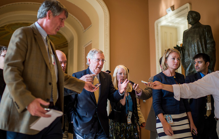 UNITED STATES - JULY 15: Senate Minority Leader Mitch McConnell, R-Ky., walks from the Senate floor to the Old Senate Chamber for the all-Senate Joint Conference on the filibuster on Monday, July 15, 2013. (Photo By Bill Clark/CQ Roll Call)