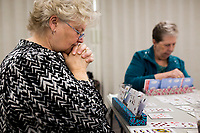 NWA Democrat-Gazette/CHARLIE KAIJO Donna Griffiths of Bella Vista (left) plays cards during a charity card party, Friday, March 15, 2019 at the Bella Vista Community Church in Bella Vista. <br /><br />The Bella Vista Garden Club held a card party - groups of four purchased a table and brought card games to play. The Garden Club and volunteers provided food. Proceeds for the event went to scholarships for horticulture students. Last year they gave two $4,000 scholarships to veterans. Over 200 people attended the event. Merchants donated over $2,000 in raffle basket prizes. <br /><br />&quot;When I opened to take reservations over 75 percent of the tables were filled in a day,&quot; said Carol Tabat, garden club member.