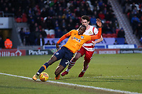 Oldham Athletic's Ousmane Fane under pressure from Doncaster Rovers' John Marquis during the Sky Bet League 1 match between Doncaster Rovers and Oldham Athletic at the Keepmoat Stadium, Doncaster, England on 16 December 2017. Photo by Juel Miah / PRiME Media Images.