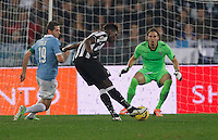 Paul Pogba shoots and scores during the Italian Serie A soccer match between   SS Lazio and FC Juventus   at Olimpico  stadium in Rome , November 22, 2014
