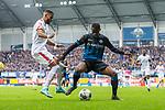 05.10.2019, Benteler Arena, Paderborn, GER, 1.FBL, SC Paderborn 07 vs 1. FSV Mainz 05<br /><br />DFL REGULATIONS PROHIBIT ANY USE OF PHOTOGRAPHS AS IMAGE SEQUENCES AND/OR QUASI-VIDEO.<br /><br />im Bild / picture shows<br />Jeremiah St. Juste (FSV Mainz 05 #04) im Duell / im Zweikampf mit Christopher Antwi-Adjei (Paderborn #22), <br /><br />Foto © nordphoto / Ewert