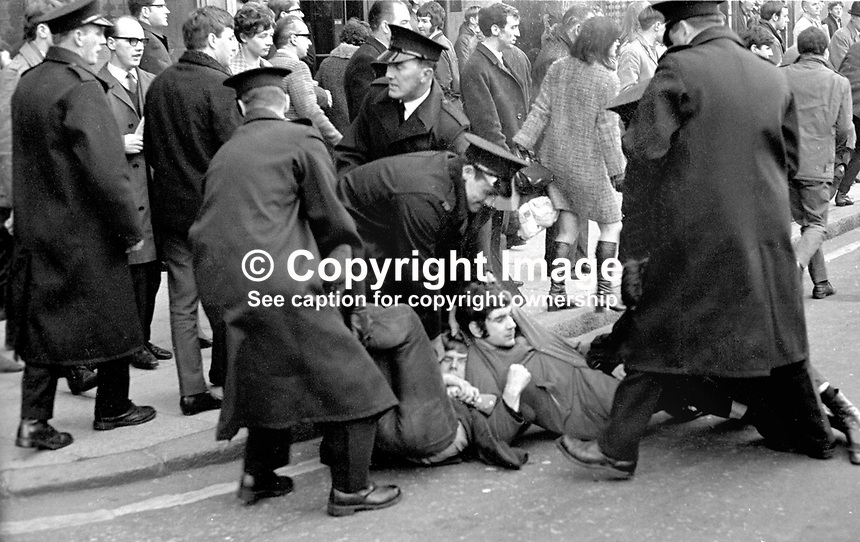 Student sit-down in Donegall Square East, Belfast, N Ireland, as part of the civil rights campaign, the precursor to the N Ireland Troubles. Pole drag away protesters. Ref: 196810160240c.<br />
