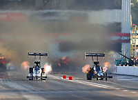 Sep 30, 2017; Madison , IL, USA; NHRA top fuel driver Shawn Langdon (left) races alongside Dom Lagana during qualifying for the Midwest Nationals at Gateway Motorsports Park. Mandatory Credit: Mark J. Rebilas-USA TODAY Sports