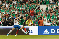 Mexico City, Mexico - Sunday June 11, 2017: Bobby Wood, Carlos Salcedo during a 2018 FIFA World Cup Qualifying Final Round match with both men's national teams of the United States (USA) and Mexico (MEX) playing to a 1-1 draw at Azteca Stadium.