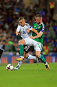Northern Ireland's Chris Brunt clashes with Germany's Joshua Kimmich during the FIFA World Cup 2018 Qualifying Group C qualifying soccer match between Northern Ireland and Germany at the National Football Stadium at Windsor Park, Belfast, Northern Ireland, 5 Oct 2017. Photo/Paul McErlane