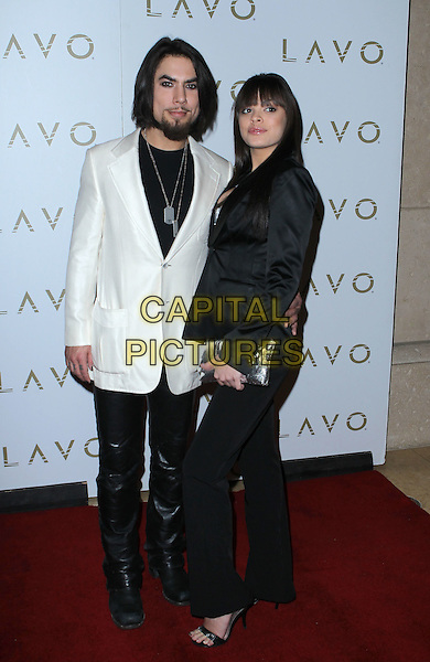 DAVE NAVARRO & RENEE PEREZ Erotica Ball Hosted by Dave Navarro at Lavo Nightclub inside the Palazzo Resort Hotel and Casino, Las Vegas, Nevada, USA, 8th January 2011..full length white jacket black shirt couple beard facial hair necklace id dog tags leather trousers .CAP/ADM/MJT.© MJT/AdMedia/Capital Pictures.