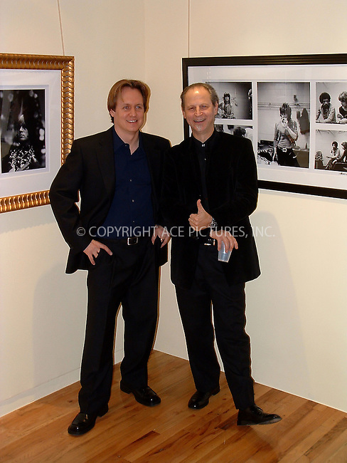 """Eddie Kramer exhibition opeing, """"From The Other Side of The Glass"""" (Rare and Historical Rock & Roll Images 1967-1972), at Aria Gallery in New York. January 9, 2003. PICTURED: Aria President Peter Kavanaugh and photographer Eddie Kramer. REF: AMUS2099. Please byline: Anthony Moore/NY Photo Press.   ..*PAY-PER-USE*      ....NY Photo Press:  ..phone (646) 267-6913;   ..e-mail: info@nyphotopress.com"""