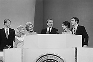 23 Aug 1972, Miami, Florida, USA --- President Richard Nixon shows his joy at being nominated as Republican presidential candidate. He will campaign for reelection against the South Dakota Democrat Senator George S. McGovern. Nixon is surrounded by his family on stage as he prepares to give his victory speech: (L-R) Edward Finch Cox and his wife Patricia Nixon Cox, Nixon's wife, Thelma Catherine Patricia Ryan Nixon, Richard Nixon, Julie Nixon Eisenhower and her husband David Eisenhower, the grandson of Former President Dwight Eisenhower. --- Image by © JP Laffont/Sygma/Corbis