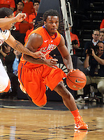 Clemson guard Rod Hall (12) drives past Virginia guard Jontel Evans (1) during the game Thursday in Charlottesville, VA.
