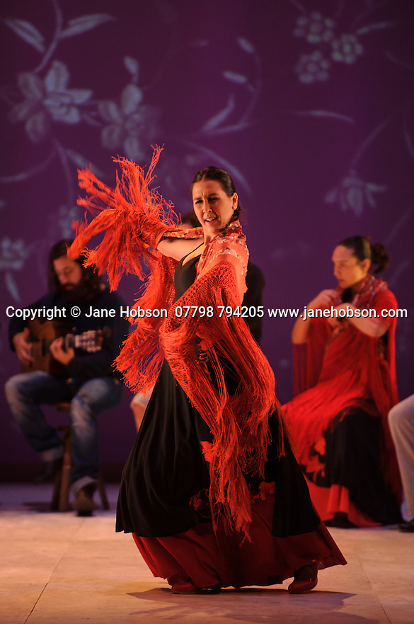 "London, UK. 20.02.2015. Ballet Flamenco de Andalucia rehearse the piece ""Las Cuatro Esquinas"", part of their production IMAGES: 20 YEARS, as part of the Flamenco Festival London 2015, at Sadler's Wells. The company is: Rafaela Carrasco (artistic Director), David Coria, Ana Morales, Hugo Lopez, Eduardo Leal, Antonio Lopez, Alberto Selles, Laura Santamaria, Alejandra Gudi, Florencia O'Ryan, Paula Comitre, Carmen Yanes. Photograph © Jane Hobson."