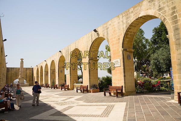 Tourists and arches in Upper Barracca Gardens, Valletta, Malta