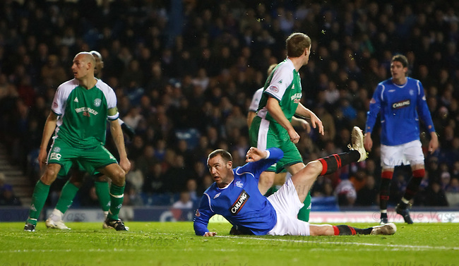 Kris Boyd watches as he scores with an overhead scissors kick as the ball lands in the top corner of the Hibs net
