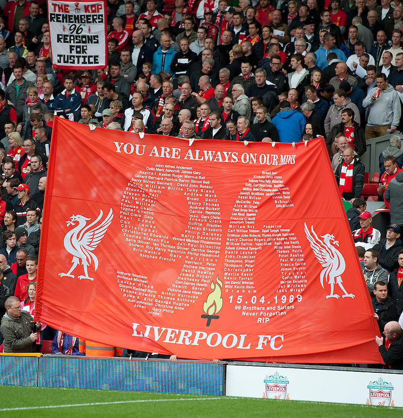 Fans hold aloft a banner in tribute to the ninetysix people who dies in the 1989 Hillsborough disaster..Football - Barclays Premiership - Liverpool v Manchester United - Sunday 23rd September 2012 - Anfield - Liverpool..
