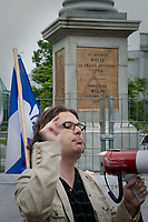"RRQ (Reseau de resistance de Quebec - Quebec Resistance network) leader Patrick Bourgeois gestures as he speaks during a protest in front of Wolfe's monument on the Plains of Abraham in Quebec city July 1, 2009. The RRQ held their annual protest against Canada by collecting Canada flags to ""send them back to the sender"".<br /> <br /> PHOTO :  Francis Vachon - Agence Quebec Presse"
