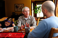 Tony Evers, Wisconsin State Superintendent of Schools, talks to family members on February 25, 2013 in Madison, Wisconsin