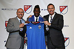 15 January 2015: Fatai Alashe (Michigan State) was selected fourth overall by the San Jose Earthquakes. With head coach Dominic Kinnear (left) and general manager John Doyle (right). The 2015 MLS SuperDraft was held at the Pennsylvania Convention Center in Philadelphia, Pennsylvania.